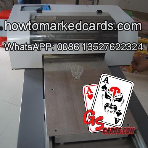 Sistema de impressão de baralho marcado.